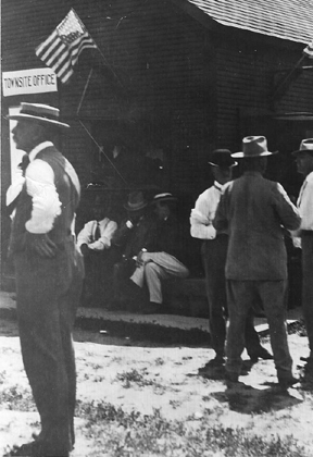 Dr. Chandler facing left in front of Townsite Office, May 17, 1912.jpg