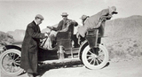 Dr. Chandler at the wheel duringa trip along the Apache Trail to the Roosevelt Dam site, 1908.jpg