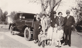 Dr Chandler and Harry Chandler Family in front on Car.jpg