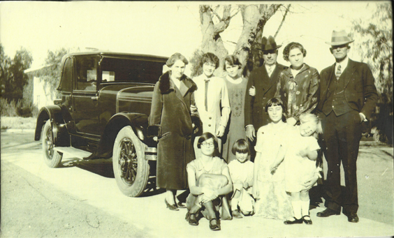 Dr. Chandler, CharlotteBoyd Chandler, and Harry Chandler Family in front of car, c. 1920s (2).jpg