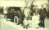 Dr. Chandler, Charlotte Boyd Chandler, and Harry Chandler Family in front of car, c. 1920s (2).jpg